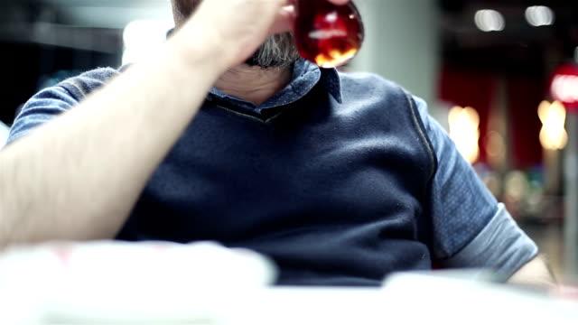 Man drinking tea at cafe video