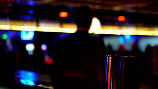 Man drinking whiskey and dancing at bar counter, relaxation on Friday night video