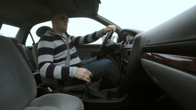LD Man driving a car and crashing