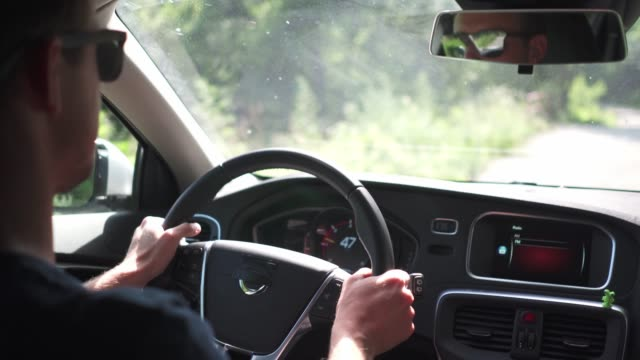 Man driving a car in the countryside Man driving a car car rental stock videos & royalty-free footage