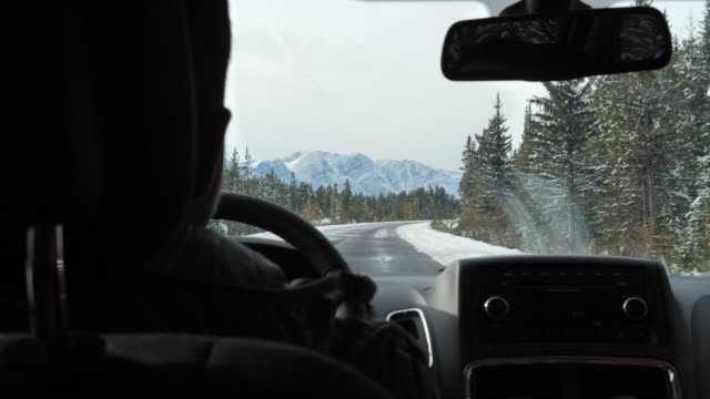 Man driving a car in Winter Man driving a car in Winter car rental stock videos & royalty-free footage