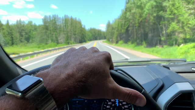 Man Driving a Car While Using Smart Watch Man Driving a Car While Using Smart Watch dashboard vehicle part stock videos & royalty-free footage