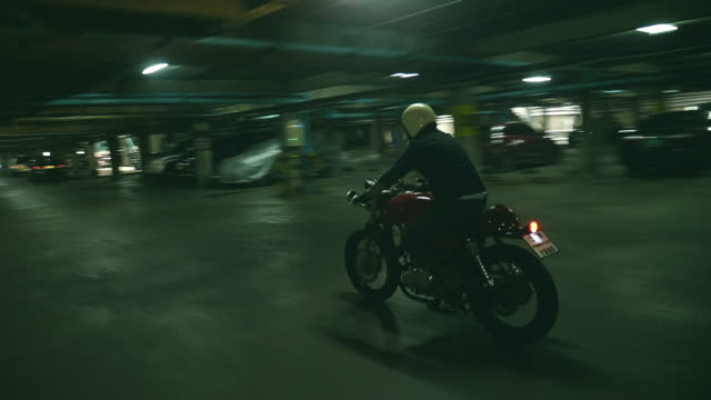 Man driving a motorcycle at dark parking video