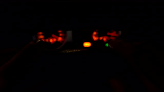 Man driving at night. FullHD close up shot of hands on the steering wheel, top view video