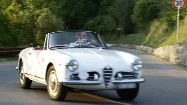 man driving cabriolet - affluent lifestyle stock videos and b-roll footage
