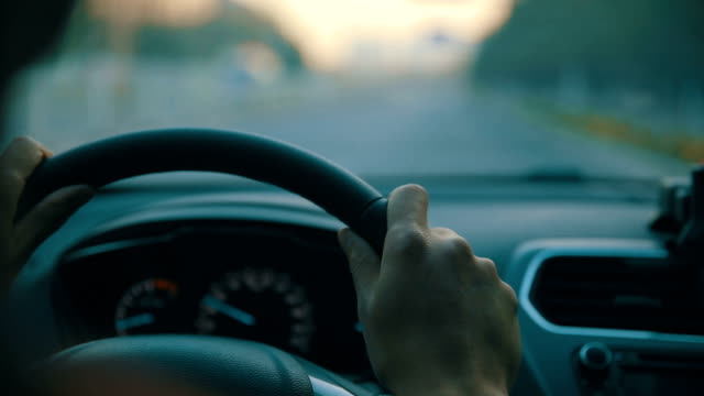 Man driving car, holding steering wheel video