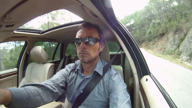 Man driving car video