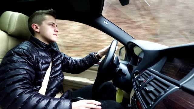 Man driving car. video