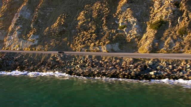 Man driving convertible, aerial shot video