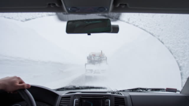 Man driving in a snow storm Man driving in a snow storm. plow stock videos & royalty-free footage