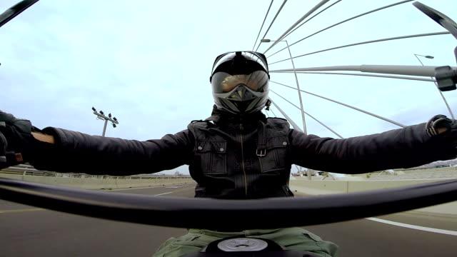 Man Driving Motorcycle Across The Bridge video