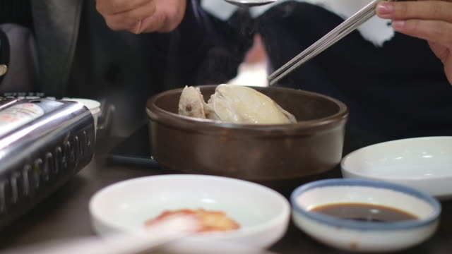 Man eat boiled chicken soup in the restaurant