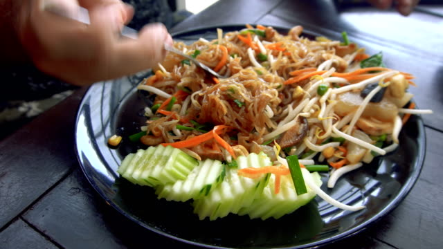 Man Eating Asian Noodle Dish Close Up video