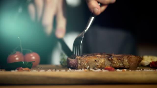 Man eating delicious beef steak video