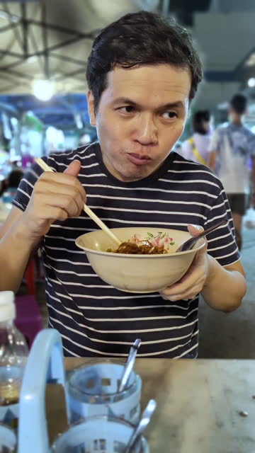 man eating noodle  Street food thailand