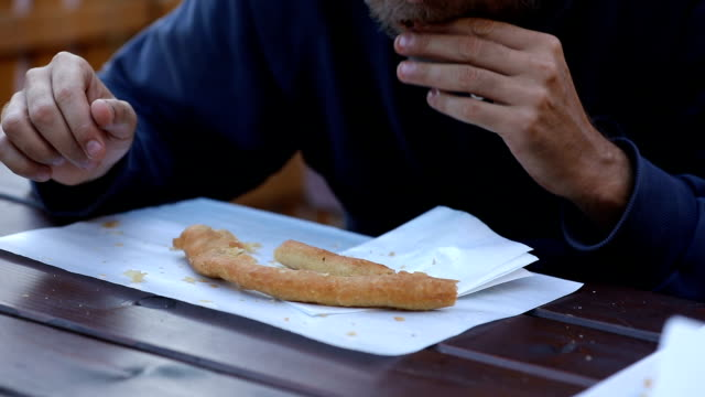 Man eating pastry for breakfast video