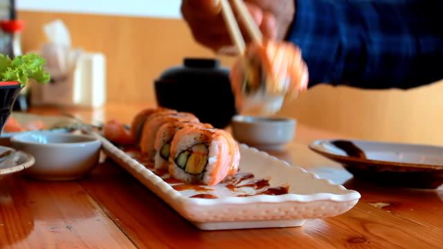 Man Eating sushi video