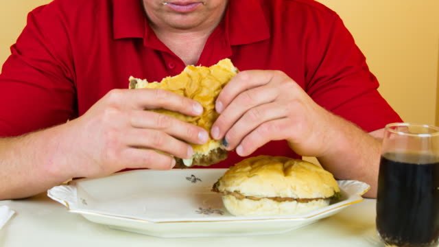 HD TIME LAPSE: Man Eating Three Hamburgers video