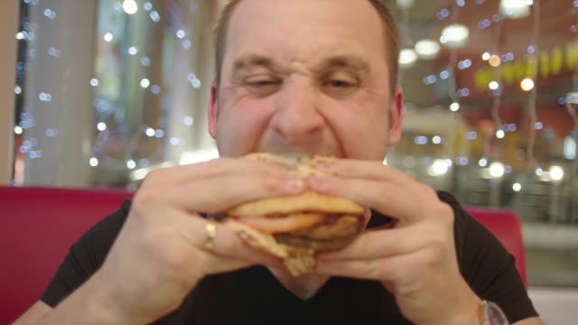 Man Enjoying Eating His Burger video