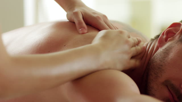 man enjoying massage - alternative medicine stock videos and b-roll footage