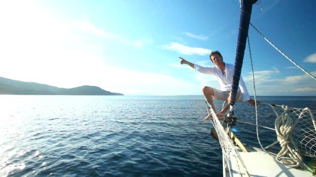 Man enjoying sailing trip on boat video