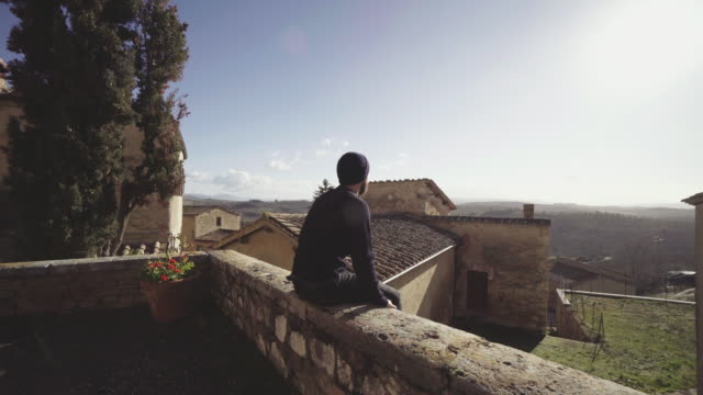 Man enjoying the sun in a rural village in Tuscany video