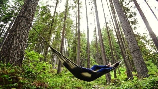 man enjoyment on the hammock - amaca video stock e b–roll