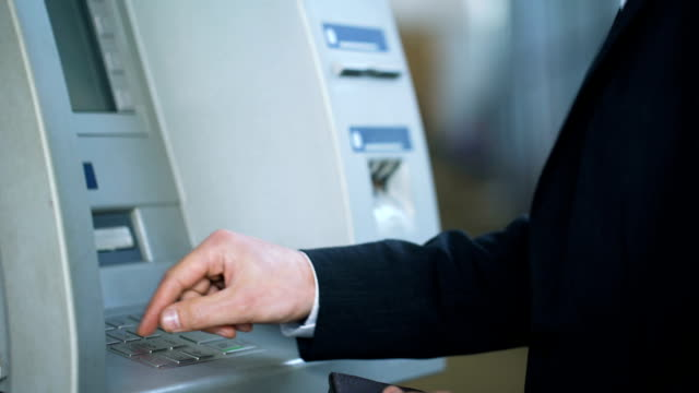 Man entering pin code on ATM keyboard and receiving euros, 24 hour service Man entering pin code on ATM keyboard and receiving euros, 24 hour service european union currency stock videos & royalty-free footage