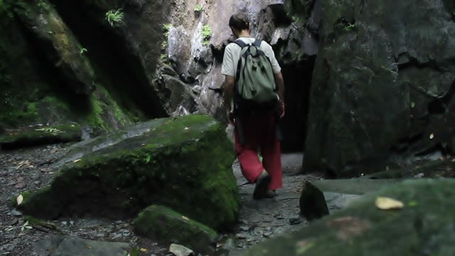 Man enters mountain cave video