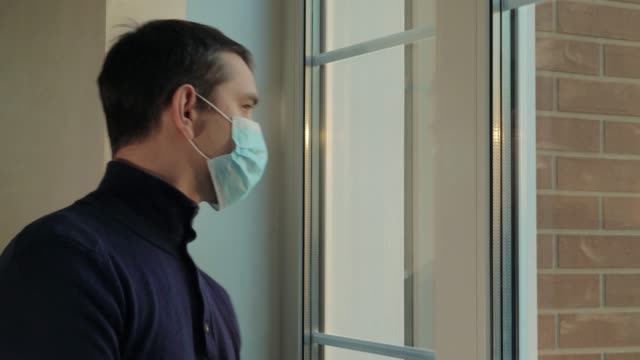 Man enters the house in a medical mask. Pandemic video