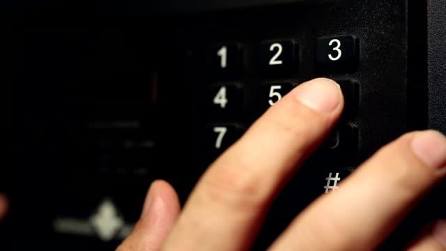 A man enters the secret code on a safe deposit box video