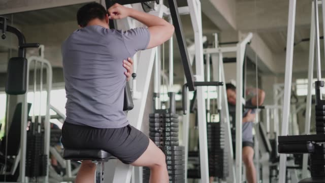 Man exercise and muscle injury then rubbing back at fitness gym. Man exercise and muscle injury then rubbing back at fitness gym. cross training stock videos & royalty-free footage