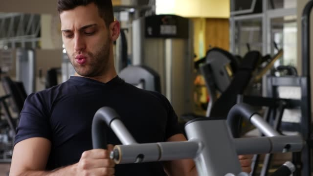 Man exercising back in gym video