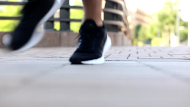 Man exercising in downtown city area. Low angle. video