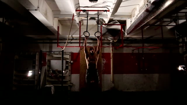 Man exercising on gymnastic rings video