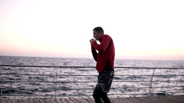 Man Exercising On Seaside Promenade Video