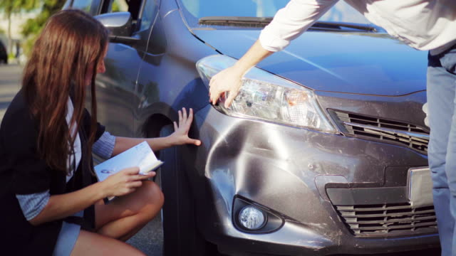 Man explaining to inspector how the car accident happened. Car crash. Broken car. 4K UHD Man explaining to inspector how the car accident happened. Car crash. Broken car. 4K UHD. wreck stock videos & royalty-free footage