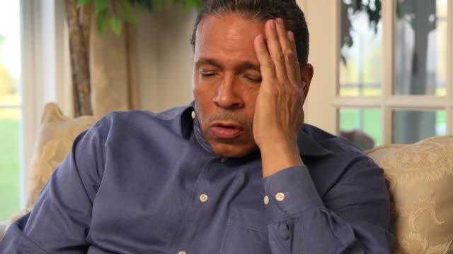 Man Expresses Concern and Sorrow Looking at Camera video