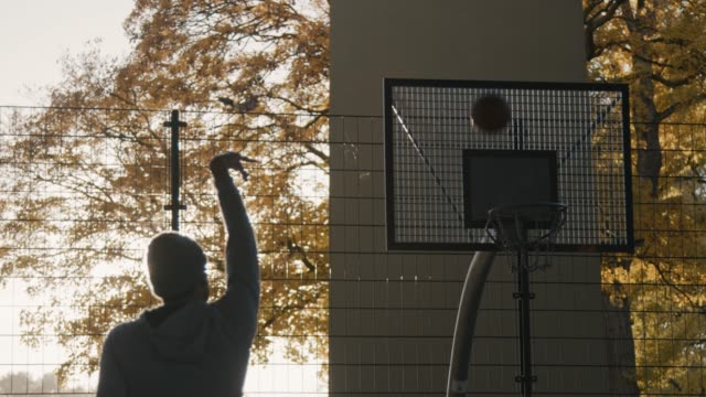 Man failing to score while playing basketball