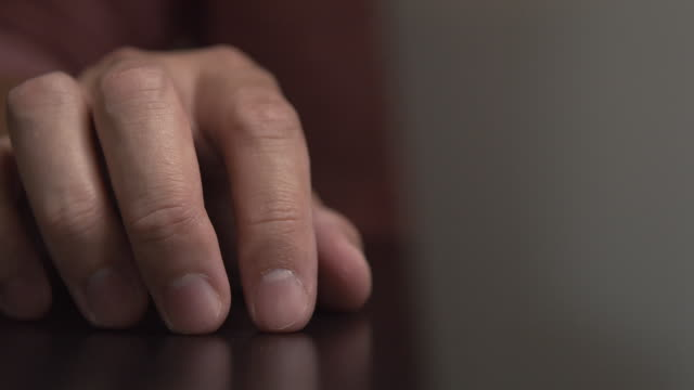 man feel Nervous and tapping his finger on the desk man feel Nervous and bored using his hand tapping finger on the desk .Close-up shot finger stock videos & royalty-free footage