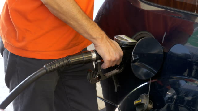 Man filling car with gas. Man's hand using a petrol pump to fill his car up with fuel video
