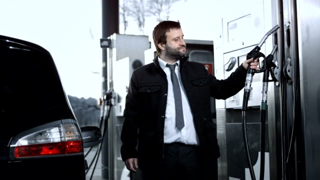 HD DOLLY: Man Filling Up A Car Gas Tank video