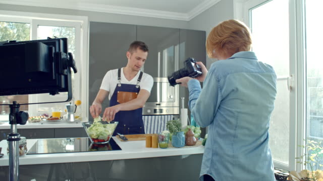 Man Filming Chef Making Salad video
