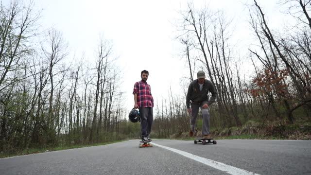 Man filming two young men Skateboarding