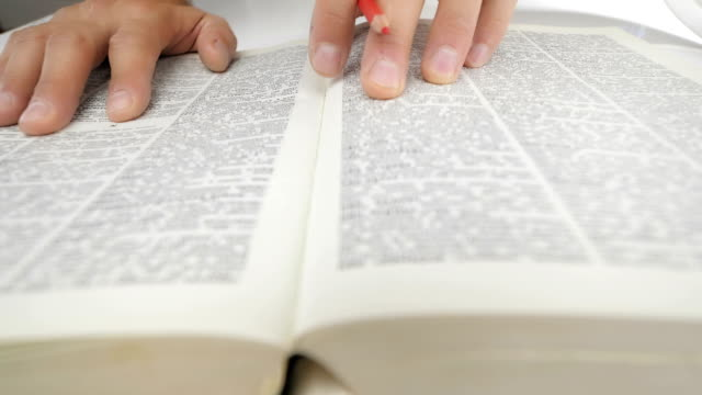 Man finds the information in the reference book. video