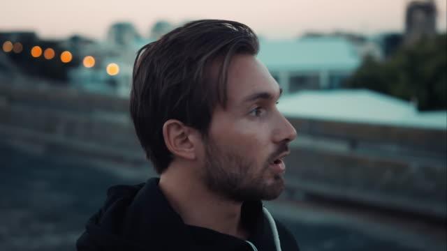 Man finishs jogging in urban setting video