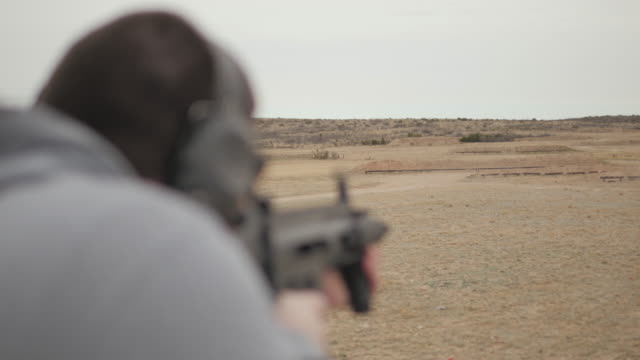 Man Fires Semi Automatic Assault Rifle to Shoot Exploding Target video