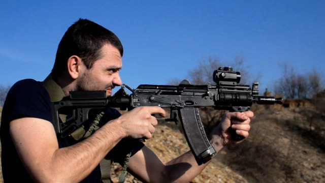 man firing customised russian machine gun, medium video