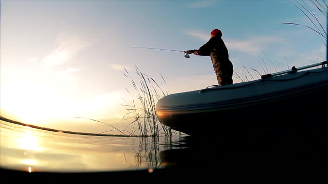 man fishing from the boat - spranga video stock e b–roll