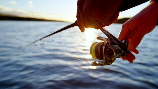 man fishing in river 4k - łowić ryby filmów i materiałów b-roll